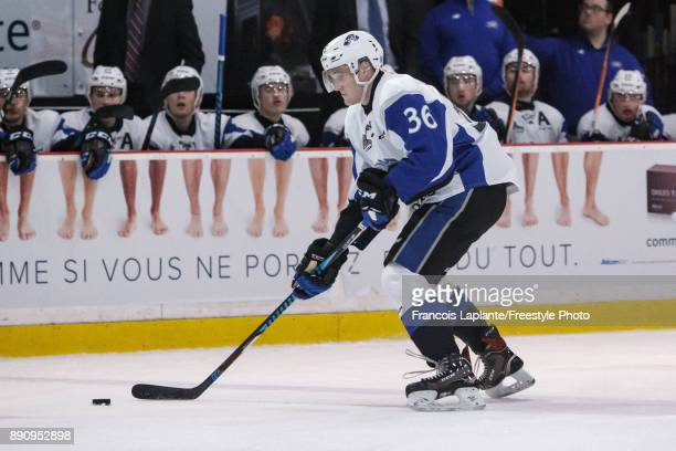 Brendan O'Reilly of the Saint John Sea Dogs skates with the puck against the Gatineau Olympiques on December 1 2017 at Robert Guertin Arena in...