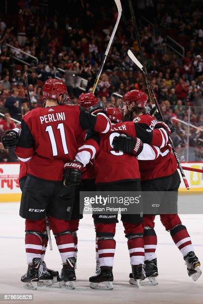 Brendan Perlini Clayton Keller and Oliver EkmanLarsson of the Arizona Coyotes celebrate after EkmanLarsson scored a power play goal against the Los...
