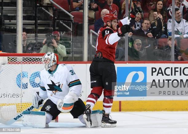 Brendan Perlini of the Arizona Coyotes celebrates behind goalie Martin Jones of the San Jose Sharks after his third period goal at Gila River Arena...