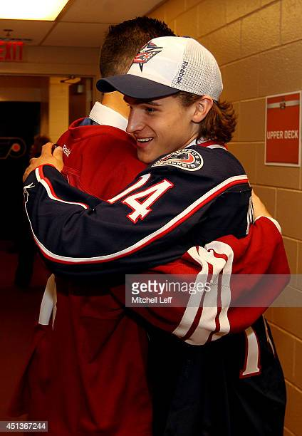 Brendan Perlini of the Arizona Coyotes celebrates with Sonny Milan of the Columbus Blue Jackets during the first round of the 2014 NHL Draft at the...