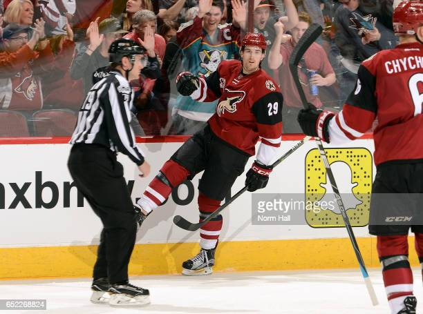 Brendan Perlini of the Arizona Coyotes pumps his fist after scoring a second period goal against the New Jersey Devils at Gila River Arena on March...