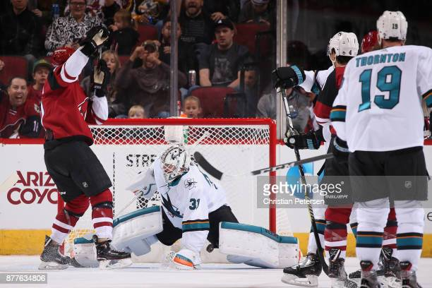 Brendan Perlini of the Arizona Coyotes scores a goal past goaltender Martin Jones of the San Jose Sharks during the third period of the NHL game at...