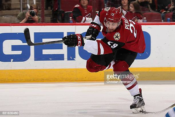 Brendan Perlini of the Arizona Coyotes shoots to score a goal against the Winnipeg Jets during the first period of the NHL game at Gila River Arena...