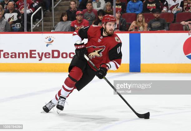 Brendan Perlini of the Arizona Coyotes skates the puck up ice against the Vancouver Canucks at Gila River Arena on October 25 2018 in Glendale Arizona