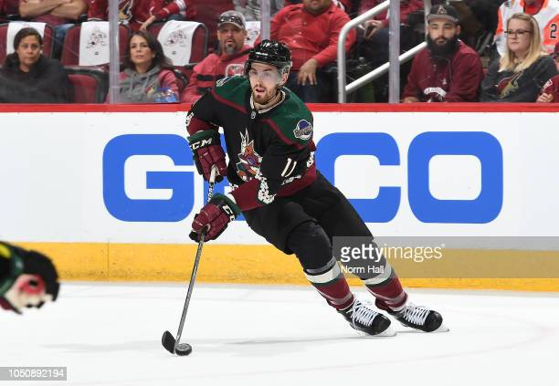 Brendan Perlini of the Arizona Coyotes skates with the puck against the Anaheim Ducks at Gila River Arena on October 6 2018 in Glendale Arizona