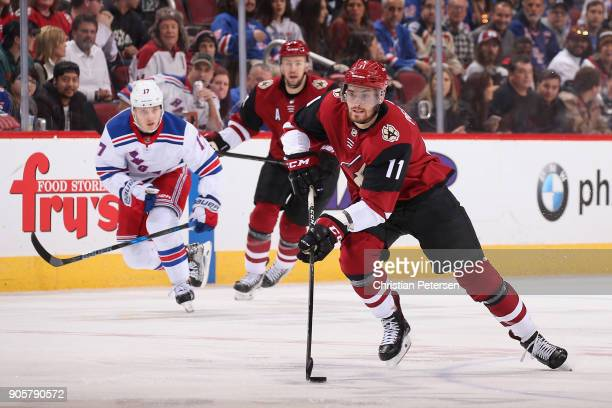 Brendan Perlini of the Arizona Coyotes skates with the puck during the NHL game against the New York Rangers at Gila River Arena on January 6 2018 in...