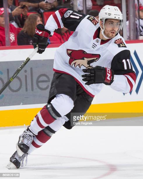 Brendan Perlini of the Arizona Coyotes turns up ice against the Detroit Red Wings during an NHL game at Little Caesars Arena on October 31 2017 in...