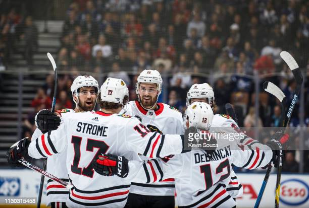Brendan Perlini of the Chicago Blackhawks celebrates his goal against the Toronto Maple Leafs with teammates Dylan Strome Alex DeBrincat Duncan Keith...
