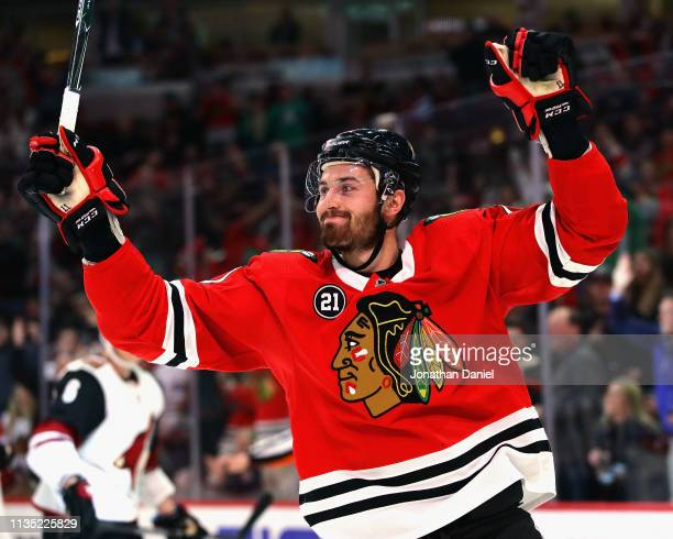 Brendan Perlini of the Chicago Blackhawks celebrates his second goal of the game against the Arizona Coyotes at the United Center on March 11 2019 in...