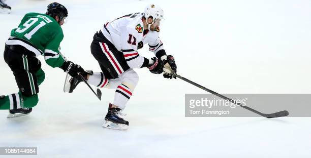 Brendan Perlini of the Chicago Blackhawks scores an empty net goal against Tyler Seguin of the Dallas Stars in the third period at American Airlines...