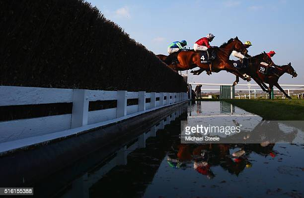 Brendan Powell on Sew On Targert , Charlie Deutsch on Niceonefrankie and Tom Scudamore on Kings Palace clear the water jump in the Brown Advisory &...