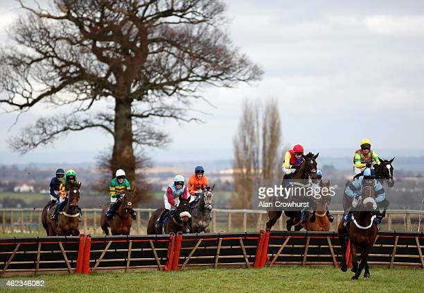 Brendan Powell riding Kingfisher Creek clear the first flight of hurdles before going on to win The 'Bulldog Chase' Novices' Hurdle Race at Taunton...