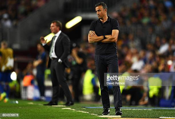 Brendan Rodgers manager of Celtic and Luis Enrique manager of Barcelona watch on during the UEFA Champions League Group C match between FC Barcelona...