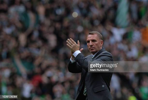 Brendan Rodgers Manager of Celtic applauds the fans at the final whistle during the Scottish Premier League match between Celtic and Rangers at...