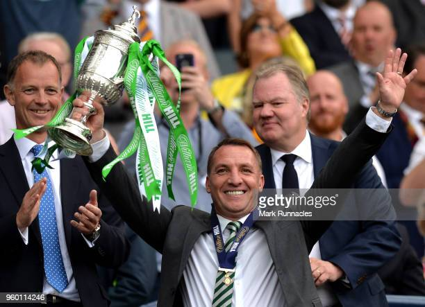 Brendan Rodgers Manager of Celtic celebrates with the Scottish Cup Trophy following the Scottish Cup Final between Motherwell and Celtic at Hampden...