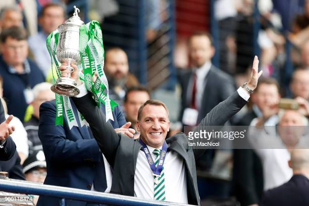 Brendan Rodgers, manager of Celtic holds the Scottish Cup Trophy following the Scottish Cup Final between Motherwell and Celtic at Hampden Park on...