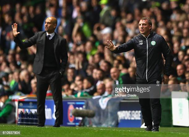 Brendan Rodgers Manager of Celtic issues instructions to his players next to Josep Guardiola Manager of Manchester City during the UEFA Champions...