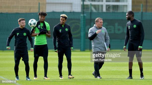 Brendan Rodgers manager of Celtic speaks to Saidy Janko of Celtic during a Celtic training session ahead of the UEFA Champions League Group B match...