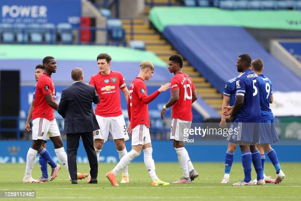 Brendan Rodgers Manager of Leicester City and Harry Maguire of Manchester United shake hands after the Premier League match between Leicester City...