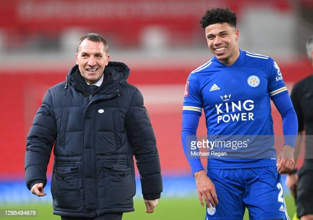 Brendan Rodgers, Manager of Leicester City and James Justin of Leicester City celebrate following their team's victory in the FA Cup Third Round...