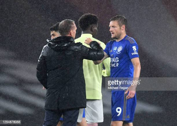 Brendan Rodgers Manager of Leicester City and Jamie Vardy of Leicester City fist bump following the Premier League match between Arsenal FC and...