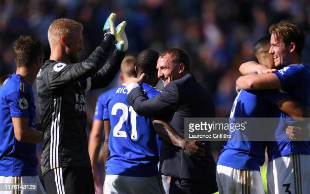 Brendan Rodgers Manager of Leicester City celebrates victory with Ricardo Pereira after the Premier League match between Leicester City and Tottenham...
