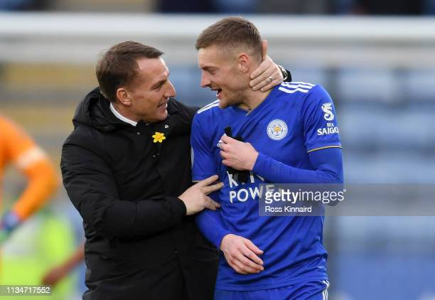 Brendan Rodgers Manager of Leicester City congratulates Jamie Vardy of Leicester City following the Premier League match between Leicester City and...