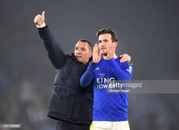 Brendan Rodgers, Manager of Leicester City embraces Ben Chilwell of Leicester City as they celebrate towards their fans at full-time after the...