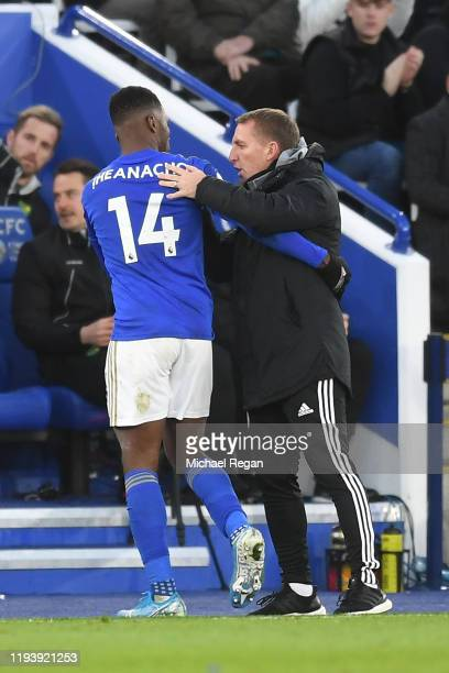 Brendan Rodgers, Manager of Leicester City embraces Kelechi Iheanacho of Leicester City is substituted off for Demarai Gray of Leicester City during...