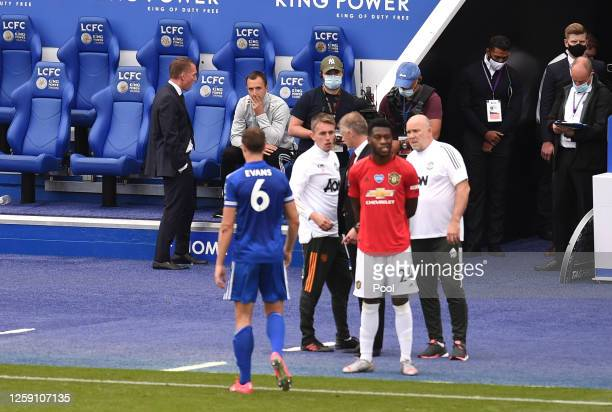 Brendan Rodgers Manager of Leicester City looks on as Jonny Evans of Leicester City walks from the pitch after receiving a red card during the...