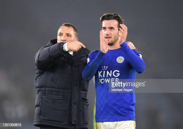 Brendan Rodgers, Manager of Leicester City points to Ben Chilwell of Leicester City as he applauds fans after the Premier League match between...