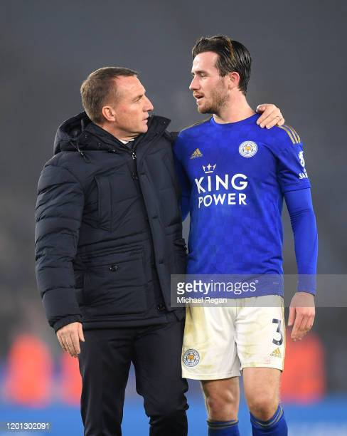 Brendan Rodgers Manager of Leicester City points to Ben Chilwell of Leicester City as he applauds fans after the Premier League match between...