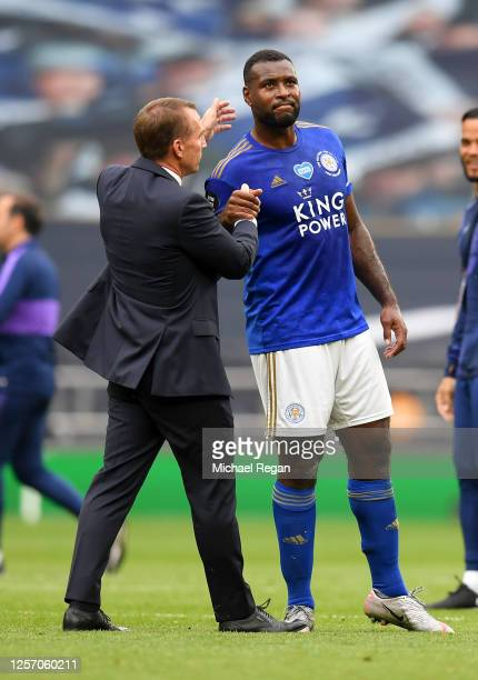 Brendan Rodgers Manager of Leicester City shakes hands with Wes Morgan of Leicester City after the Premier League match between Tottenham Hotspur and...