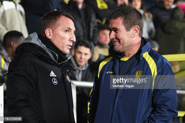 Brendan Rodgers Manager of Leicester City speaks to Nigel Clough Manager of Burton Albion prior to the Carabao Cup Round of 16 match between Burton...