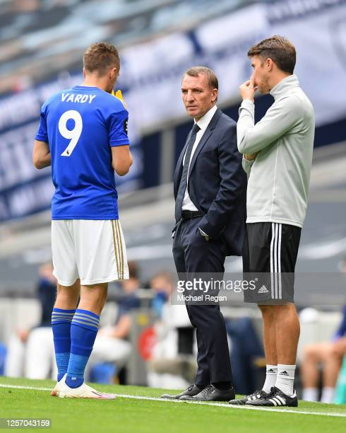 Brendan Rodgers, Manager of Leicester City speaks with Jamie Vardy of Leicester City during the Premier League match between Tottenham Hotspur and...