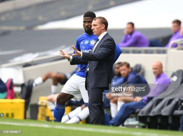Brendan Rodgers Manager of Leicester City speaks with Kelechi Iheanacho of Leicester City during the Premier League match between Tottenham Hotspur...