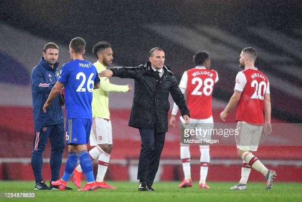 Brendan Rodgers Manager of Leicester City speaks with PierreEmerick Aubameyang of Arsenal following during the Premier League match between Arsenal...
