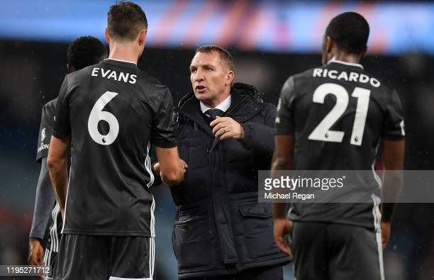 Brendan Rodgers, Manager of Leicester City talks to Jonny Evans of Leicester City following the Premier League match between Manchester City and...