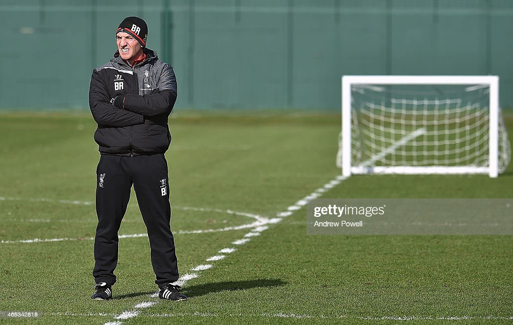 Brendan Rodgers manager of Liveprool looks on during a training session at Melwood Training Ground on March 6, 2015 in Liverpool, England.