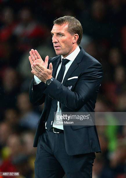 Brendan Rodgers manager of Liverpool applauds during the Barclays Premier League match between Arsenal and Liverpool at Emirates Stadium on August 24...