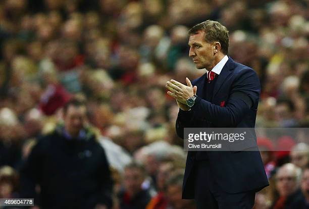 Brendan Rodgers manager of Liverpool applauds on the touchline during the Barclays Premier League match between Liverpool and Newcastle United at...
