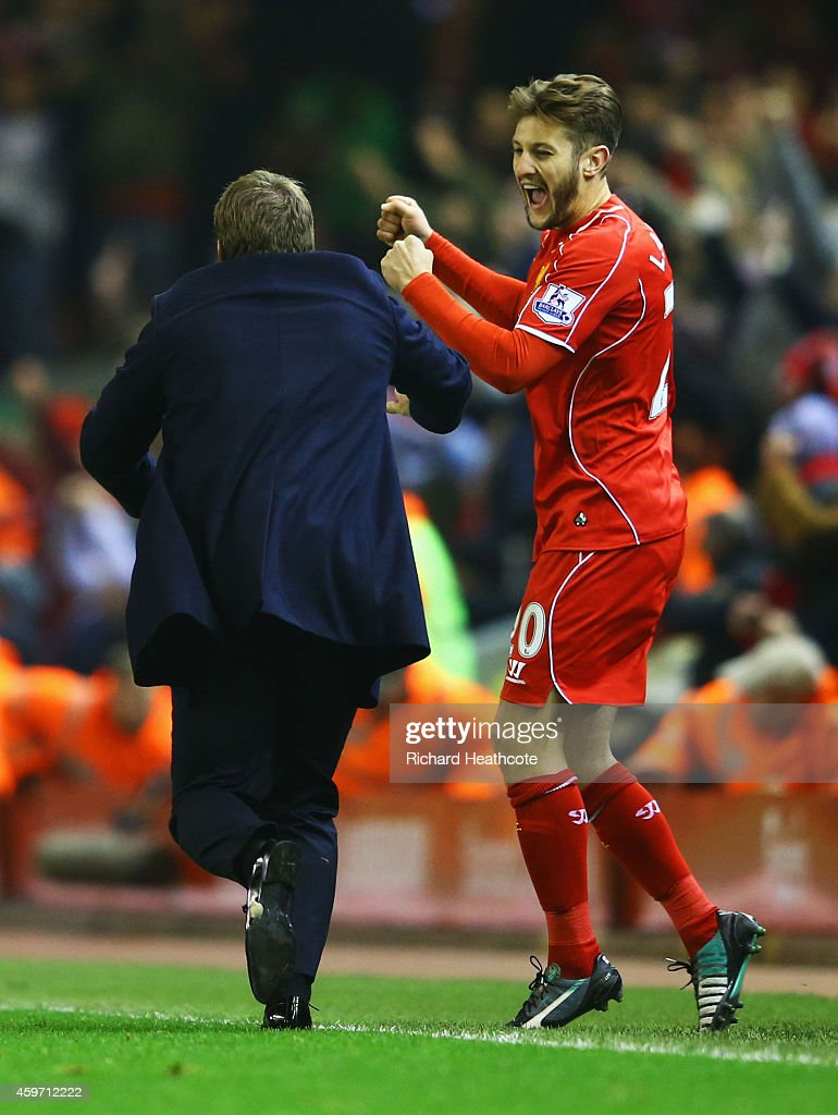 Brendan Rodgers manager of Liverpool celebrates with Adam Lallana of Liverpool as Glen Johnson (not pictured) scores their first goal during the Barclays Premier League match between Liverpool and Stoke City at Anfield on November 29, 2014 in Liverpool, England.