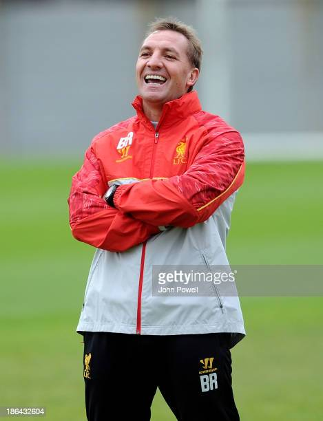 Brendan Rodgers manager of Liverpool laughing during a training session at Melwood Training Ground on October 31 2013 in Liverpool England