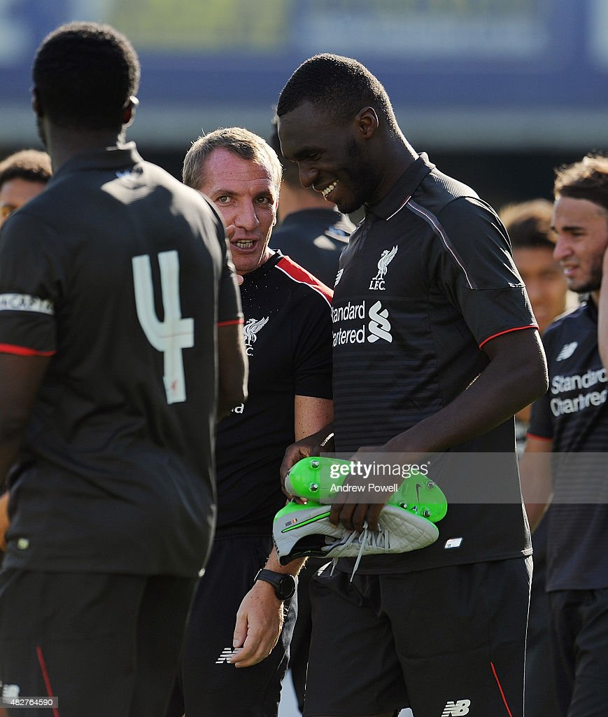 Brendan Rodgers manager of Liverpool laughs with Christain Benteke at the end of a preseason friendly at County Ground on August 2, 2015 in Swindon, England.