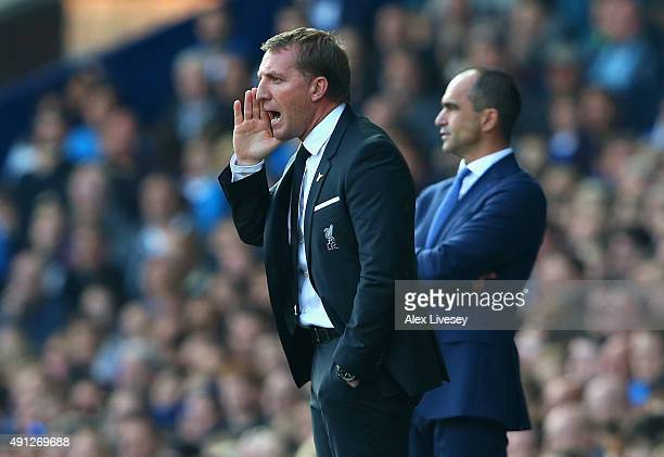 Brendan Rodgers manager of Liverpool reacts as Roberto Martinez manager of Everton looks on during the Barclays Premier League match between Everton...