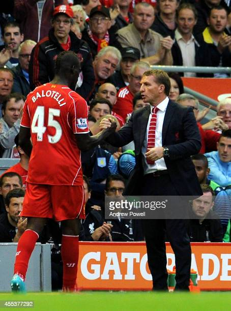 Brendan Rodgers manager of Liverpool shakes hands with Mario Balotelli as he is substituted during the Barclays Premier League match between...
