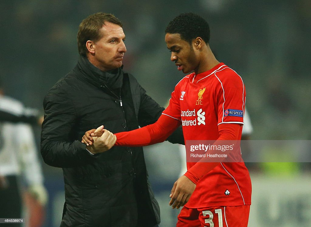 Brendan Rodgers manager of Liverpool shakes hands with Raheem Sterling of Liverpool after defeat in a penalty shoot out during the UEFA Europa League Round of 32 second leg match between Besiktas JK and Liverpool FC on February 26, 2015 in Istanbul, Turkey.