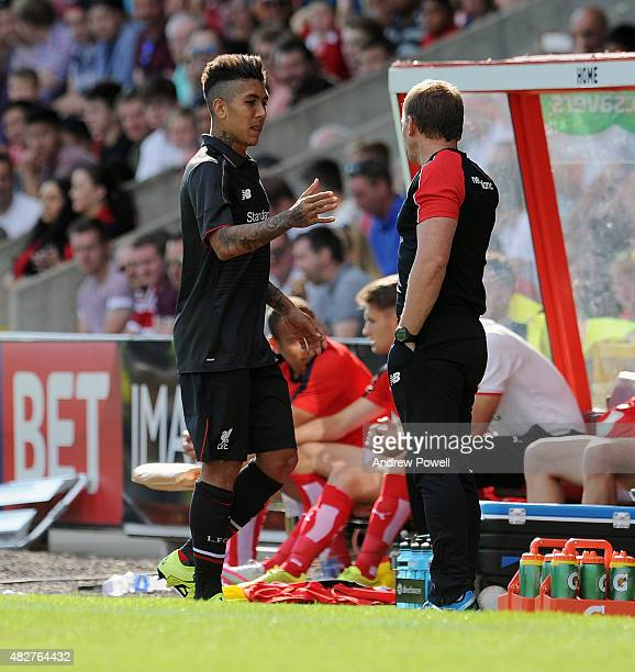 Brendan Rodgers manager of Liverpool shankes hands with Roberto Firmino during a preseason friendly at County Ground on August 2, 2015 in Swindon,...
