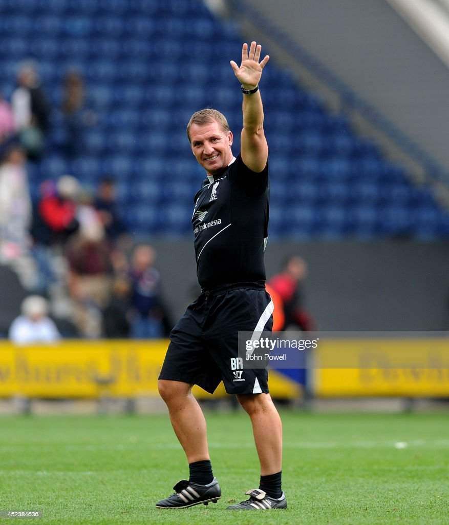 Brendan Rodgers manager of Liverpool show his appreciation to the fans at the end of the Pre Season friendly match between Preston North End and Liverpool at Deepdale on July 19, 2014 in Preston, Lancashire.