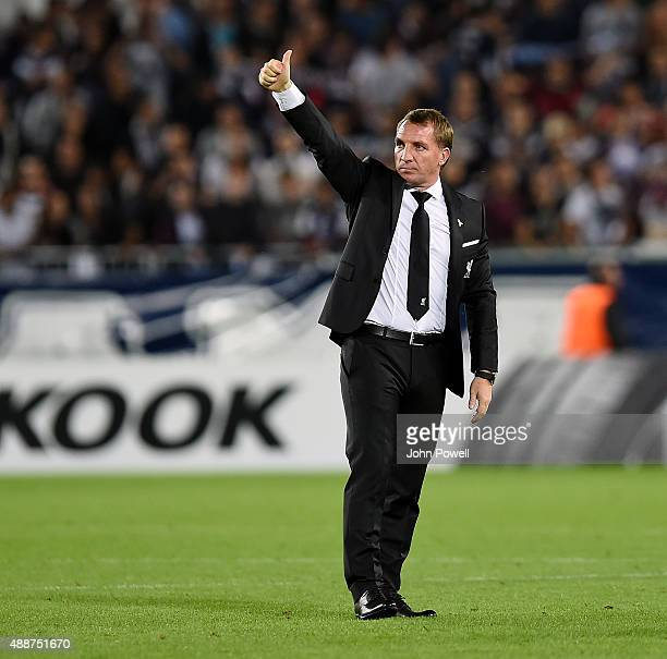 Brendan Rodgers manager of Liverpool shows his appreciation to the fans at the end of the UEFA Europa League match between FC Girondins de Bordeaux...